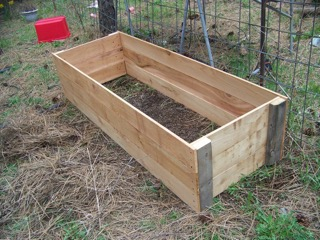 Make your own raised bed flower or veggie garden the for Wooden flower bed ideas